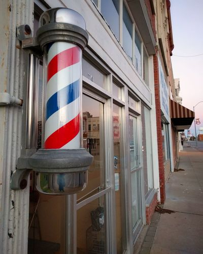 A recently repaired barber pole in downtown Nevada, MO. No People Outdoors Architecture Tradition Building Exterior Day Barbershop Barber Barber Shop Barber Pole First Eyeem Photo