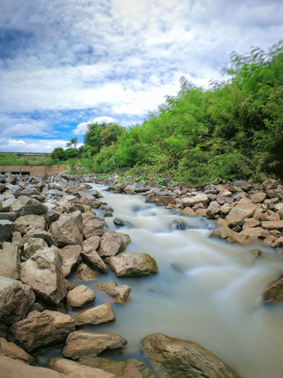 Scenic view of stream against sky