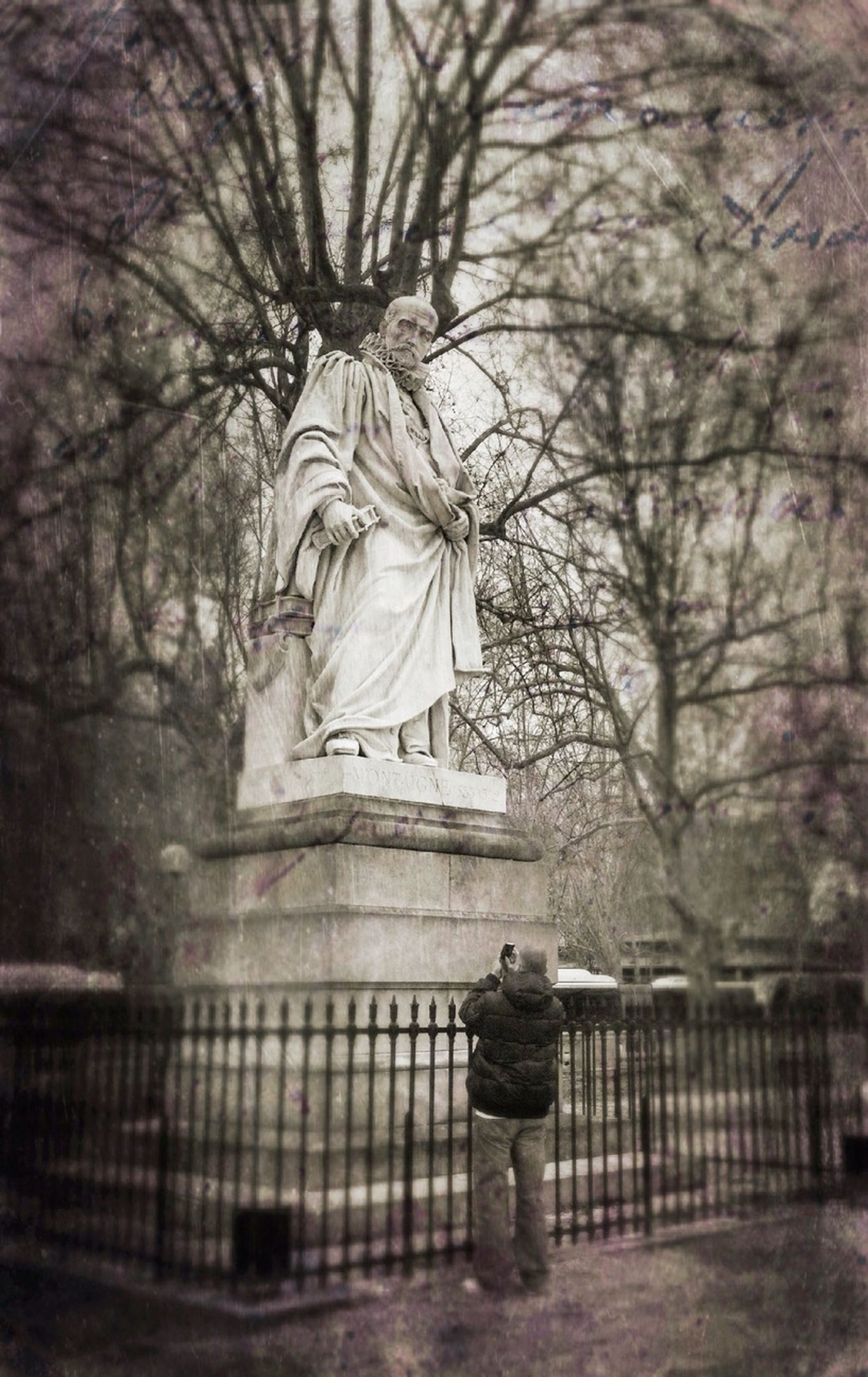 rear view, water, tree, statue, lifestyles, leisure activity, religion, full length, standing, human representation, person, lake, built structure, men, architecture, sculpture, spirituality, bare tree
