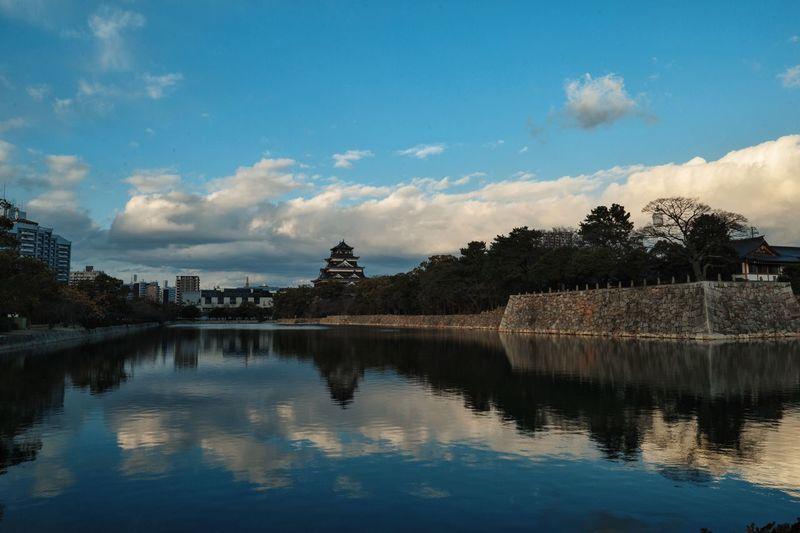 Okayama Castle With Reflection In Asahi River Against Sky