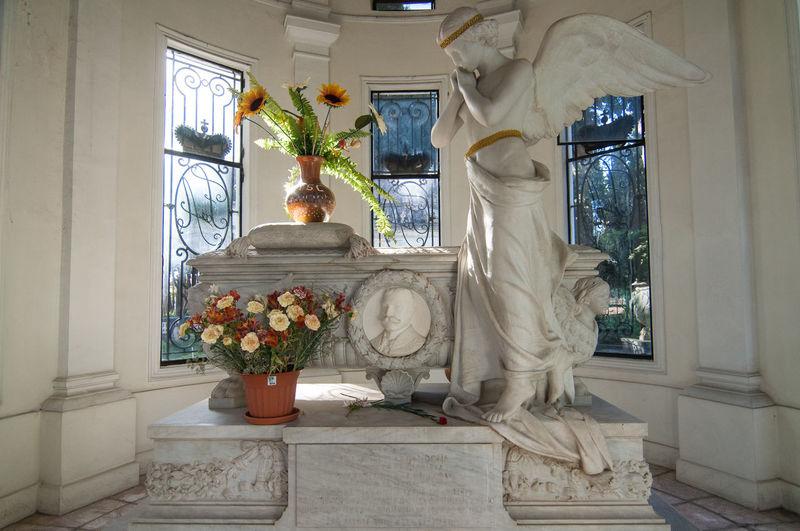 Statue by window