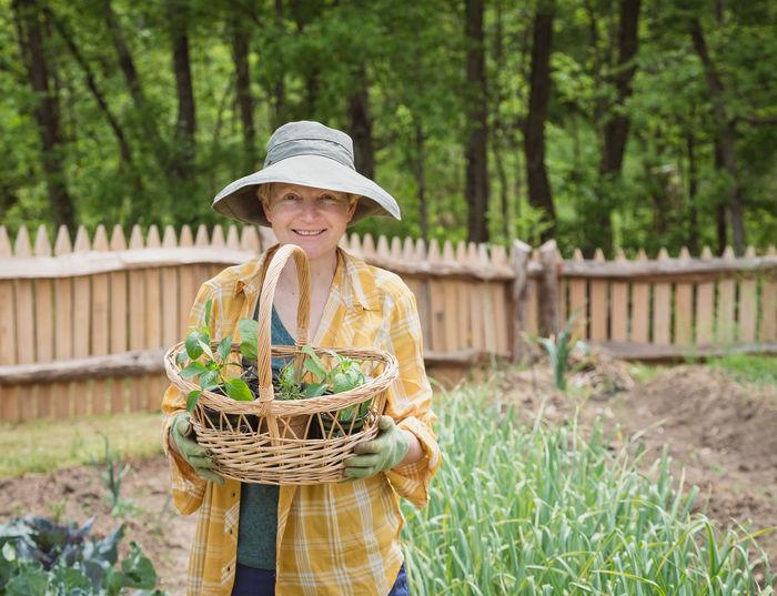 Portrait of smiling woman holding basket