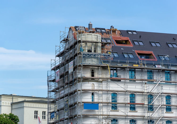 building under construction, facade with scaffolding Built Structure Architecture Building Exterior No People Low Angle View Outdoors Construction Industry Residential District Apartment Window Industry Sunlight Balcony Sky Clear Sky Building City Nature Day Modern Scaffolding Facades