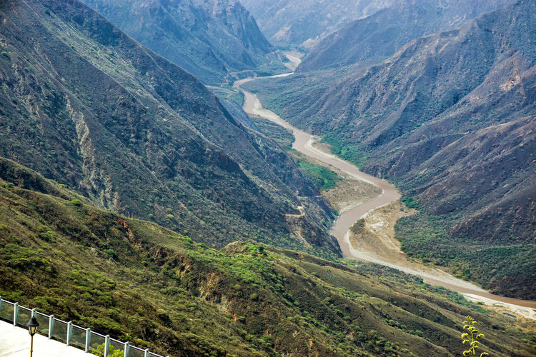 Landscape of the Chicamocha Canyon and river in Santander, Colombia Mountain Scenics - Nature Landscape Nature Beauty In Nature Outdoors Tree Plant Colombia Santander Chicamocha Chicamocha Canyon Park Canyon Panachi Bucaramanga River Green Scenic Background Scene Adventure National Park Tourism Mesa De Los Santos America South America Latin Latin America