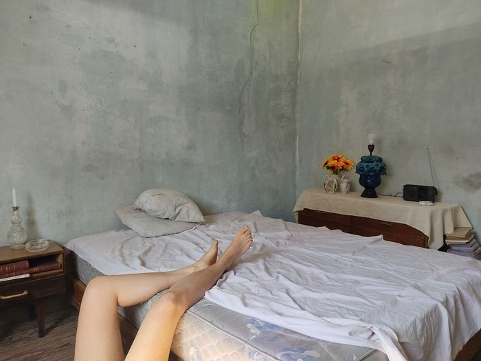 People relaxing on bed at home