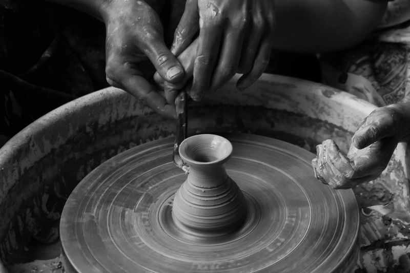 Cropped Image Of Hands Making Pot At Workshop