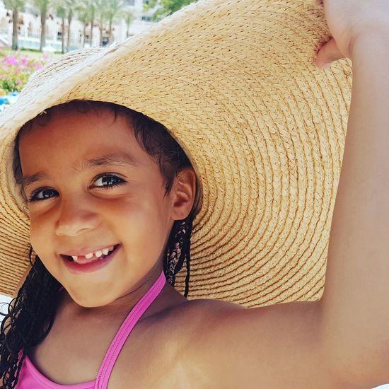 First Eyeem Photo girl hat swimming pool holiday Holiday Swimming Pool Close-up Smile RedSea Bink Hat Portrait
