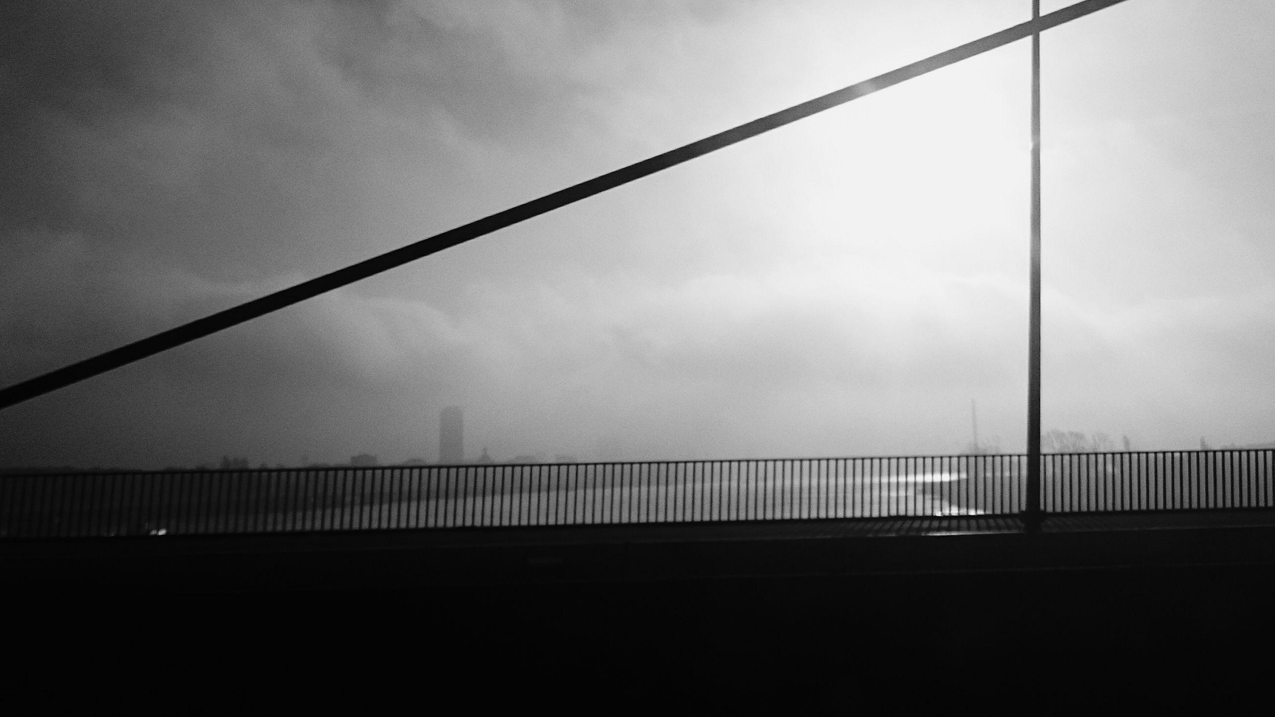 bridge - man made structure, sky, suspension bridge, connection, cloud - sky, transportation, no people, built structure, outdoors, day, architecture, river, water, bridge, nature