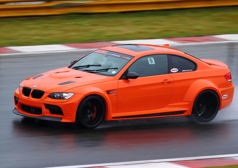 Auto Racing Bmw Car Car Day EyeEmNewHere Famous Driver Motorsport No People Orange Color Outdoors Racetrack Speed Sports Car Sports Race Still Life