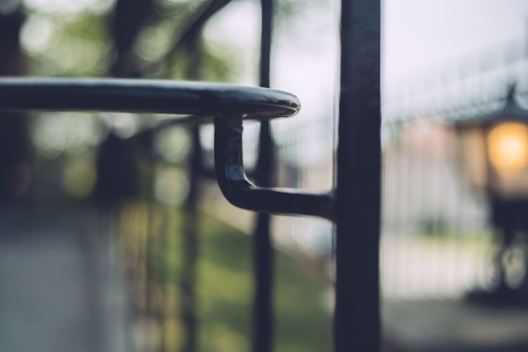 Barrier Black Color Boundary Chain Close-up Day Fence Focus On Foreground Gate Handle Hanging Metal Nature No People Outdoors Protection Railing Safety Security Selective Focus Wrought Iron