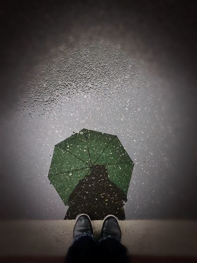 Low section of person standing on wet floor during rainy season