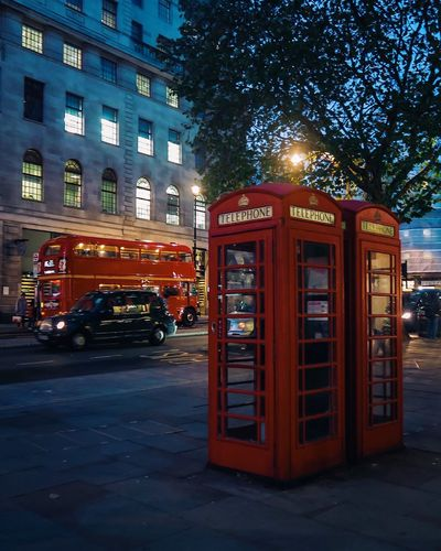 Phone Boxes. Taxi. London Bus Telephone Booth Telephone Street Red Pay Phone Built Structure City Night No People Phone Box Telephone Box London Routemaster Taxi London Bus London Cab Illuminated Outdoors