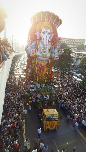 "India Great Indian Festival God Lord Ganesha Son Of Lord Siva Deceptively Simple people have lot of love on god. Every Indian participate in "" Ganesh chaturthi"" festival. 100+ft lord Ganesh statue. Capture The Moment SagarReddy"