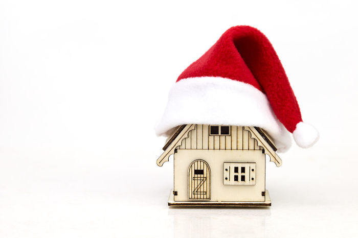 toy wooden house in red cap Santa Claus on white background Christmas Santa Cap Red Cap Santa Santa Claus House Dwelling Cottage Village New Year MAS Xmas Christmas Decoration Christmas Decoration Christmas Preparations White Background Free Space Free Space For Text Gift Celebrate Celebration Eve Decoration Cozy No People Time White Background Indoors