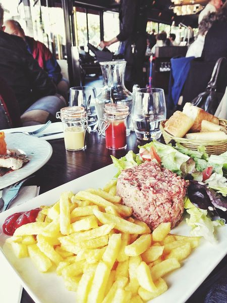 Enjoying Life Eating Delicious Raw Beef French Fries Restaurant Lunch