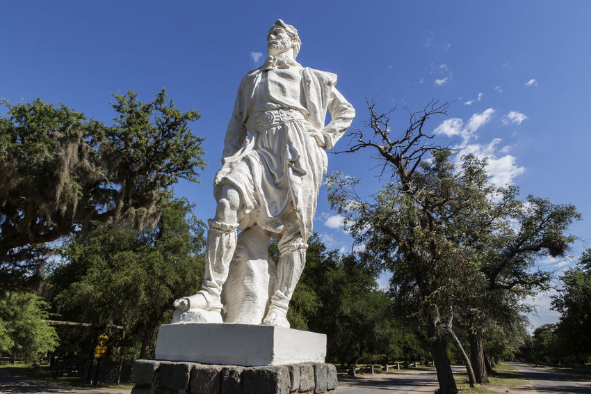 El Gaucho Tau Sculpture Statue Art And Craft Tree Human Representation Representation Plant Sky Male Likeness Low Angle View Creativity Nature No People Day Architecture Craft Memorial Stone Material Park Park - Man Made Space