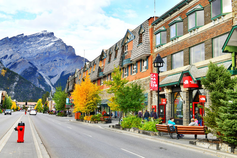 Street view of famous Banff Avenue in Banff National Park.Canada Transportation City Road Building Exterior Architecture Built Structure Sky Nature Day Plant Outdoors