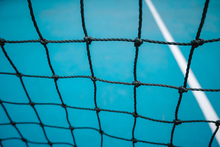Full frame shot of net against sky