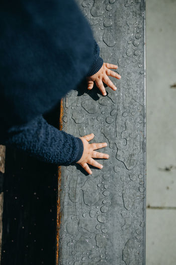 High angle view of man hand on wall