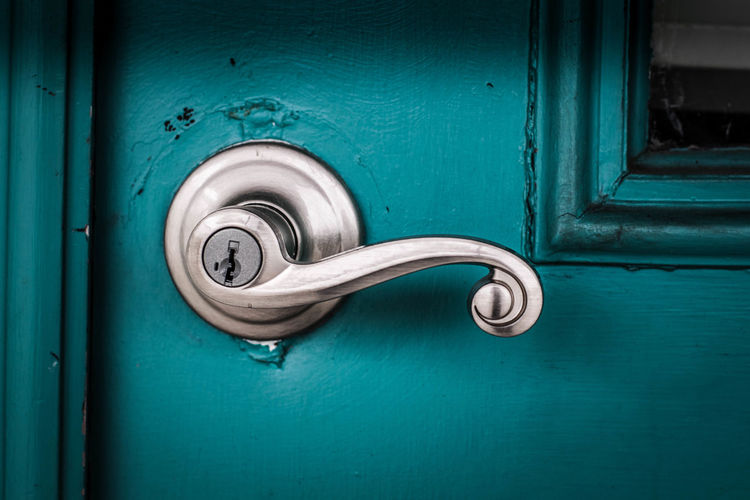 Full frame shot of blue door and handle