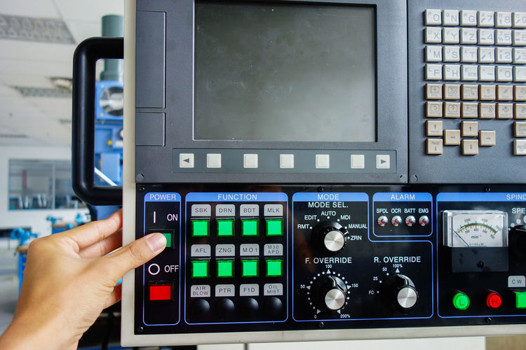 Close-up of hand using control panel