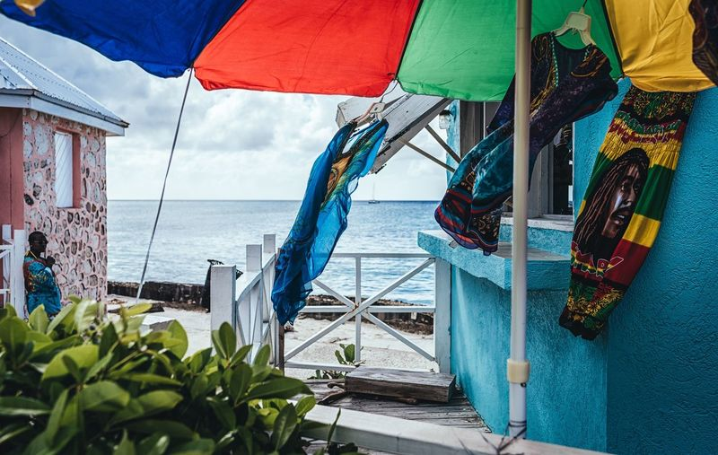 Island Life Windy Yellow Color Blue Color Green Color Red Color One Person Caribbean Island Photographyisthemuse Nikon D750 Travel Photography Travel Destinations Turks And Caicos Colorful For Sale Sea Beach Water Day Outdoors Nautical Vessel Sky Horizon Over Water Beauty In Nature