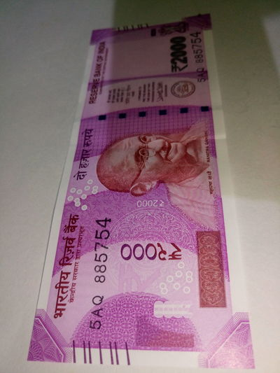Indian two thousand rupee note 2000 Banknote Business Close-up Currency Currency Indian Finance Finance And Economy Indian Culture  Indian Currency Indian Two Thousand Rupee Note Indoors  New No People Paper Currency Pink Color Savings Success Text Two Thousand Rupee Note Wealth