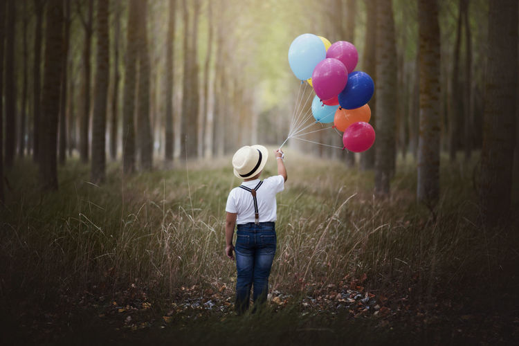 Children Dream Dreaming Freedom Growth Independence Pensive Serenity Travel Balloon Boys Child Childhood Children Only Forest Helium Balloon Melancholy Multi Colored Nature Outdoors Rear View Relaxation Sadness Solitude Tree