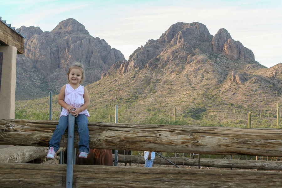 Ironwood Forest National Monument Casual Clothing Child Childhood Day Front View Full Length Innocence Leisure Activity Lifestyles Looking At Camera Men Mountain Nature One Person Portrait Real People Sky Standing Wood - Material