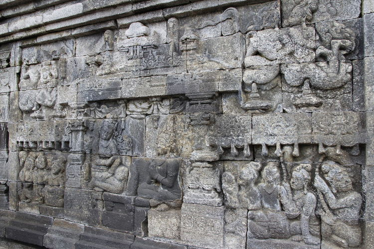 Beautiful bas-relief wall decor carved in stone at Borobudur Temple, Yogyakarta, Indonesia Carvings In Stone INDONESIA Wall Yogyakarta Ancient Ancient Civilization Architecture Art And Craft Bas Relief Bas-relief Borobudur Buddhism Built Structure Carving Carving - Craft Product Craft History Human Representation No People Outdoors Religion Representation Rocks Stone Wall The Past