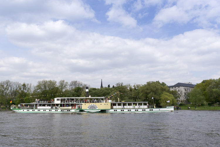 Germany-view of the paddle-steamer on the river Elbe in Dresden, Saxony Europe Germany Paddle Wheels Paddle-steamer Passenger Steamboat Steamschip White Fleet Dresden / Germany Elbe River Riverboot Saxony