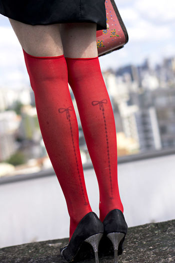 The red stocking Low Section City Red Human Leg Standing Shoe Close-up Stockings Leg Lingerie Skin