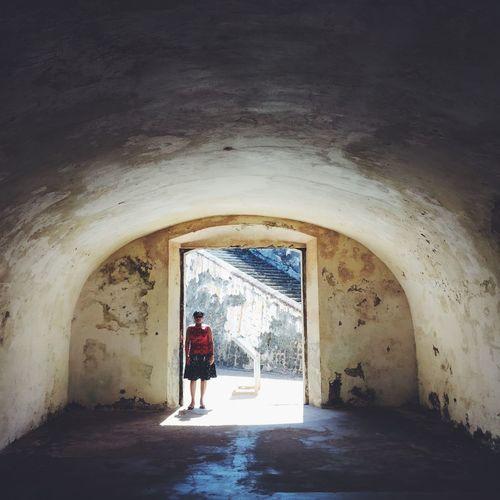 Woman walking in corridor