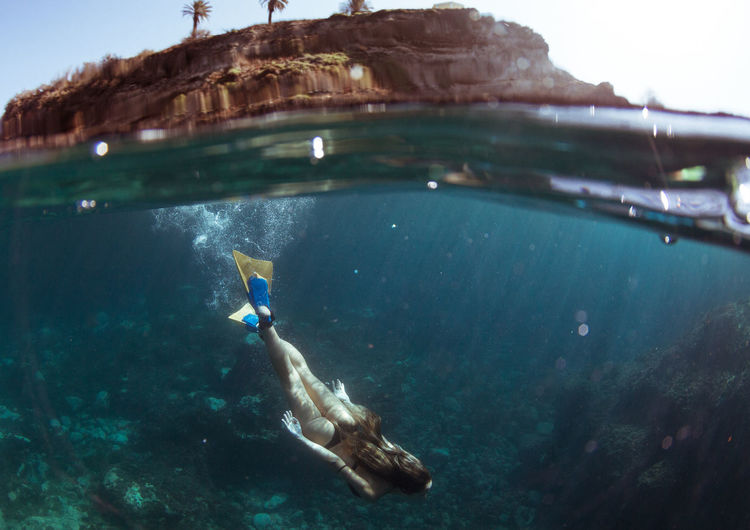 Woman swimming in sea at canary islands