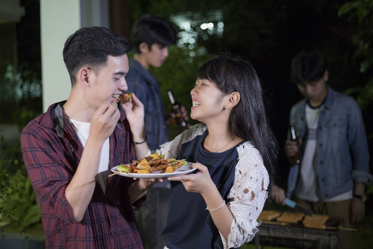 Bonding Casual Clothing Couple - Relationship Emotion Food Food And Drink Friendship Front View Group Of People Happiness Leisure Activity Lifestyles Men Outdoors Positive Emotion Real People Standing Teenager Togetherness Women Young Adult Young Men Young Women