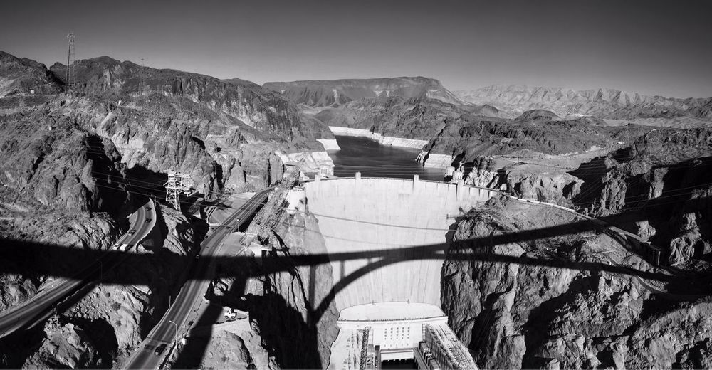 The bridge's long shadow...Hoover Dam... The Illuminator - 2014 EyeEm Awards The Environmentalist – 2014 EyeEm Awards The Explorer - 2014 EyeEm Awards Monochrome Throw A Curve IPSShadows Learn & Shoot: Leading Lines Seeing The Sights RePicture Growth How Do We Build The World?