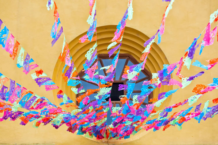 Decorations outside the Santo Domingo de Guzman Catholic Church. Architectural Feature Art And Craft Colorful Creativity Culture Day Decorated Decoration Hanging Low Angle View Multi Colored Mural Outdoors Religion Spirituality Variation Vibrant Color