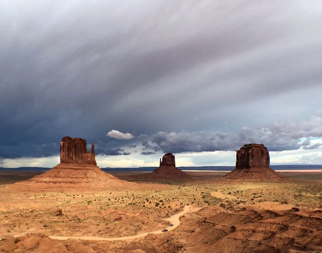 Nature Desert Sky Cloud - Sky Arid Climate Scenics Physical Geography Geology Beauty In Nature Tranquility Tranquil Scene Sand Dune Sand Landscape Travel Rock - Object Outdoors Travel Destinations Monument Valley Tourism Travel USA Natural Landmark Finding New Frontiers Miles Away