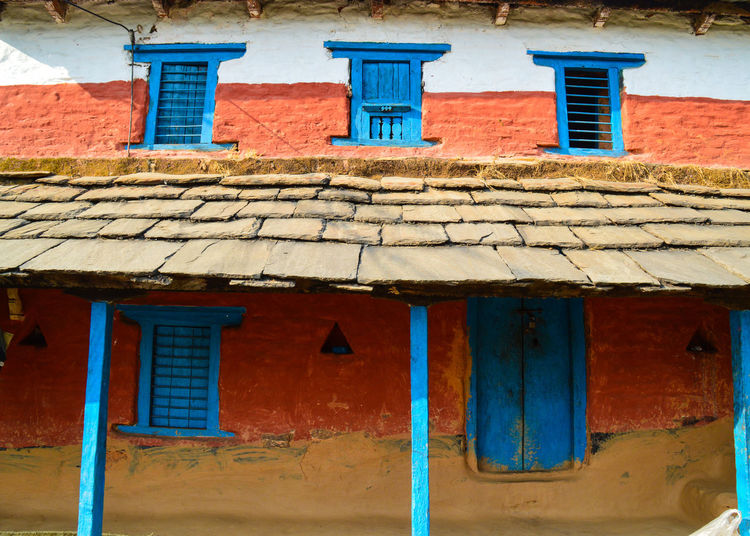 Architecture Building Exterior Built Structure Window Red Day Multi Colored Outdoors Sunlight Roof No People Traditional House Nepal Abstract Minimalism Traditional Nepali House Colorful House Mud House Travel Photography Travel EyeEm Diversity