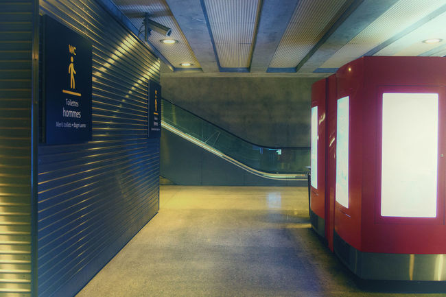 Architectural Column Architecture Built Structure Ceiling Communication Direction Empty Flooring Fluorescent Light Illuminated Indoors  Light Lighting Equipment No People Public Transportation Sign Subway Subway Station Text The Way Forward Transportation Tunnel Underground Walkway Underpass Wall - Building Feature
