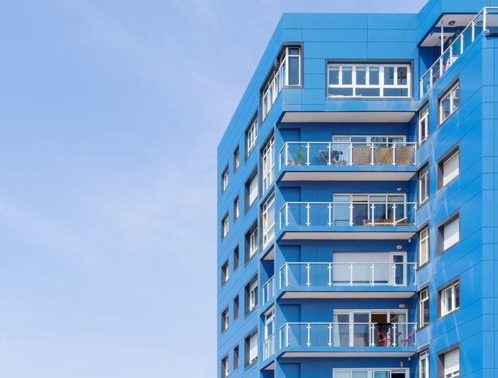 Low angle view of blue building against clear sky