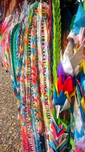 A lot paper cranes in Japan Multi Colored Outdoors No People Day Flag Close-up EyeEmNewHere Japanese Temple Memories Japan Japanese Culture Paper Cranes