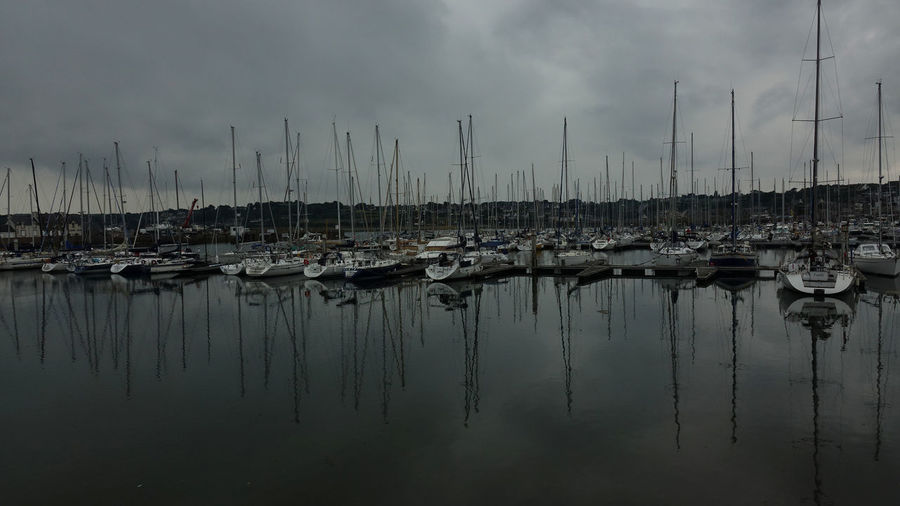 Sailing Water Rainy Day At The Sea Hello And Welcome Nautical Vessel Reflection Moored Mode Of Transportation Sailboat Transportation Sky Pole Cloud - Sky Mast Harbor No People Waterfront Nature Beauty In Nature Tranquility Lake Marina Outdoors Yacht Port