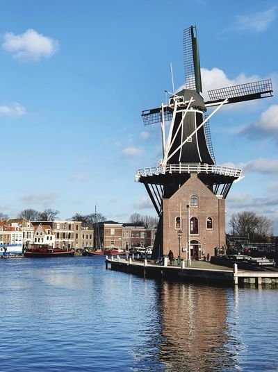 Water Architecture Sky Built Structure Building Exterior Wind Turbine Renewable Energy Environmental Conservation No People Cloud - Sky Fuel And Power Generation River Waterfront Turbine Nature Alternative Energy Traditional Windmill Wind Power Day Outdoors