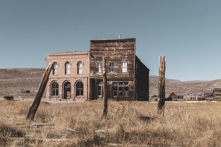 Ghosttown Bodie -> Goldrush 1859 Abandoned Blue Sky Built Structure Day Ghost Town Historical No People Outdoors Sunny Day Texture Wood - Material