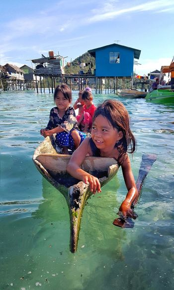 The Sea Gypsies of Tatagan Island, Semporna Sabah, Malaysia Semporna Children Tatagan Island Malaysia Amazing Destination Travel Caroline Majanil Sabah Water Sea Gypsies Beautiful Outdoors Real People Childhood Smiling Happiness People Leisure Activity Nautical Vessel