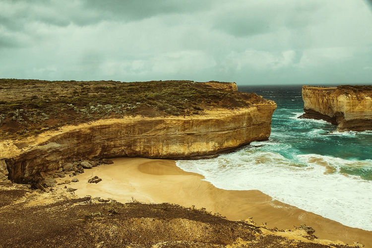 the twelve apostles-landscape II , australia Beach Beauty In Nature Rock - Object Rock Formation Rock Land Scenics - Nature Cloud - Sky Sky Sea Wave Nature No People Tranquil Scene Non-urban Scene Outdoors Water Day Tranquility Solid Motion Eroded Power In Nature