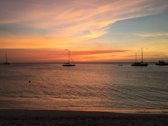 Sunset Sea Water Sky Nautical Vessel Cloud - Sky Transportation Scenics - Nature Beauty In Nature Orange Color Mode Of Transportation Tranquil Scene Idyllic Horizon Over Water Tranquility No People Beach Nature Sailboat Land