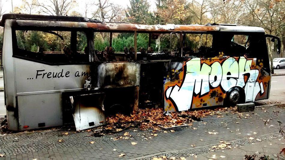 burned bus Streetart