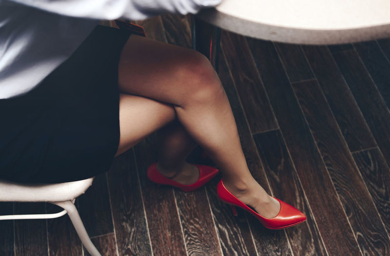 Beautiful legs business woman in red high-heeled shoes. Low Section Human Leg Shoe Chair One Person Adult Women Seat Fashion Sitting High Heels Body Part Human Body Part Females Real People Indoors  Lifestyles Relaxation Human Foot Beautiful Woman Human Limb Luxury EyeEmNewHere International Women's Day 2019